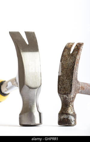Two hammers, one old one new on a white background