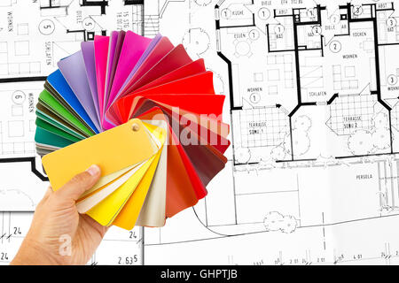 Rainbow color palette and construction plan in background - Stock Photo