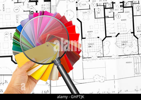 Rainbow color palette with magnifier and construction plan in background - Stock Photo