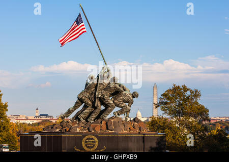 The US Marine Corps War Memorial with Washington landmarks in the background in Arlington, Virginia. - Stock Photo