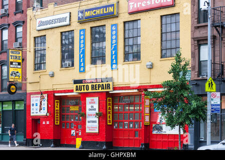 The colorful facade of Cybert Tire, an auto repair shop and tire center in New York City. - Stock Photo