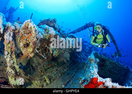 Shipwreck Aida and scuba diver inside the Wreck, Brother Islands, Brothers, Big Brother, Red Sea, Egypt, Africa - Stock Photo