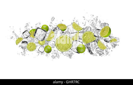Pieces of limes in water splash and ice cubes, isolated on white background - Stock Photo