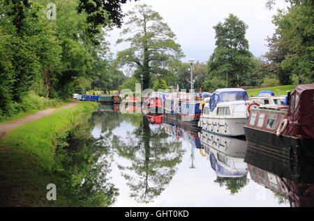 Narrowboats moored on the Monmouthshire and Brecon Canal at Goytre Wharf near Abergavenny, South Wales, Cymru, UK - Stock Photo