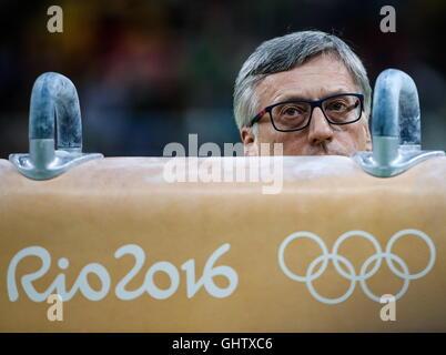 Rio De Janeiro, Brazil. 10th Aug, 2016. Gennady Sartinsky, coach of Ukrainian gymnast Oleg Verniaiev, looks on during - Stock Photo