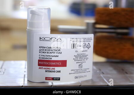 Moscow, Russia. 10th Aug, 2016. Labelling of KORA Phytocosmetics cream bottles at a manufacturing facility of the - Stock Photo