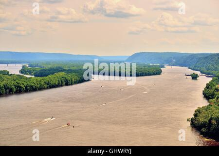 Pleasure crafts and boats are plentiful on a channel of the Mississippi River near Harpers Ferry, Iowa, USA. - Stock Photo