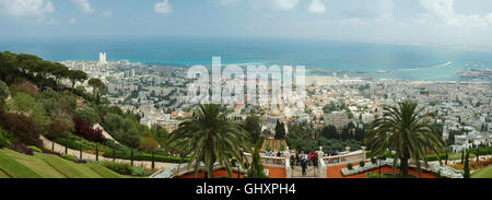 HAIFA, ISRAEL - MAY 6,2011: Tourists visit famous Bahai shrine .Bahai temple gardens is famous sacred place in Israel, - Stock Photo