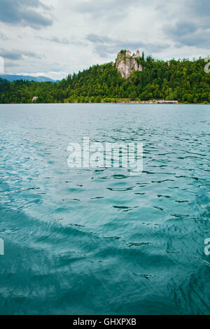 Bled castle with lake in foreground in Slovenia - Stock Photo