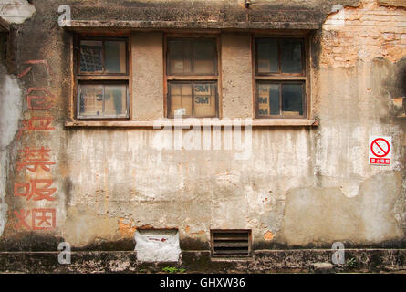 old writings on factory building in Guangzhou china - Stock Photo