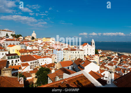View of the Alfama neighborhood in Lisbon, Portugal from the Portas do Sol viewpoint; Concept for travel in Lisbon, - Stock Photo