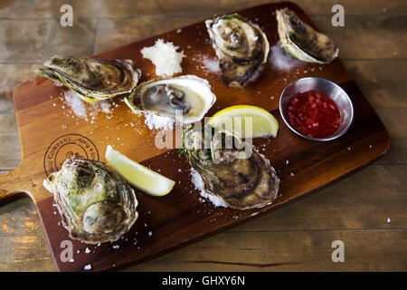 A board of Price Edward Island oysters served at St John's in Newfoundland and Labrador, Canada. - Stock Photo