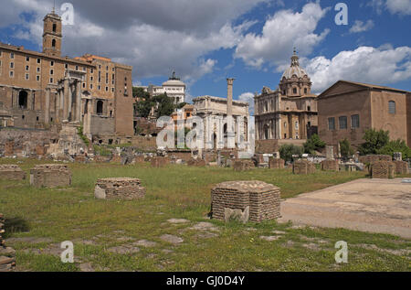General view north over the Roman Forum area, Temple of Saturn on left and Arch of Settimio Severo in centre,  Rome, - Stock Photo