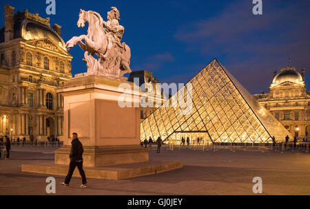 the Palais du Louvre at dusk, Paris, France - Stock Photo