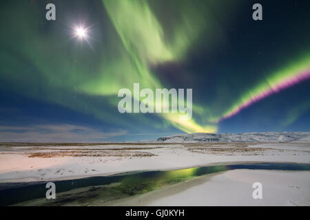 the Northern Lights (Aurora Borealis) over Hornafjörður, eastern Iceland - Stock Photo