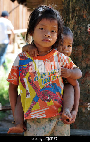 Young children in a remote village, Mekong River, Laos - Stock Photo