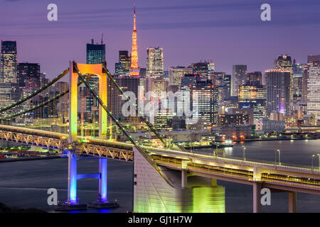 Tokyo, Japan cityscape at Rainbow Bridge and Tokyo Tower. - Stock Photo