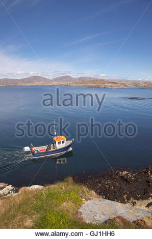 A wildlife watching and fishing boat trip off the coast of the Isle of Harris, Outer Hebrides, Scotland. - Stock Photo