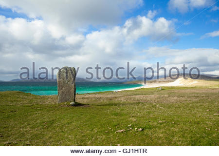 A standing stone at Borvemore, with a view to beaches beyond, Isle of Harris, Outer Hebrides, Scotland - Stock Photo