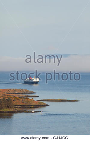 The MV Isle of Mull Caledonian MacBrayne Ferry sails into Oban Bay, Argyll, Scotland. - Stock Photo
