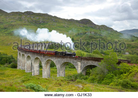 The Jacobite steam train passing over the Glenfinnan Viaduct, Lochaber, Highlands of Scotland. - Stock Photo