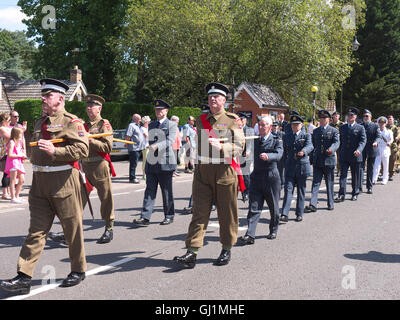 Reenactors and veterans parading through the Woodhall Spa to the war memorial for the remembrance service as part - Stock Photo