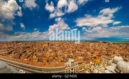 Aerial panoramic view of Venice, with St Mark's Square and the basilica domes in the foreground. - Stock Photo