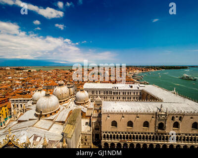 Aerial view of St Mark's Basilica domes and Doge's Palace looking out toward St Mark's Basin. Venice. Italy. - Stock Photo