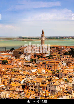 Aerial view of Venice rooftops, with the bell tower of San Francesco della Vigna in the distance. Venice, Italy - Stock Photo