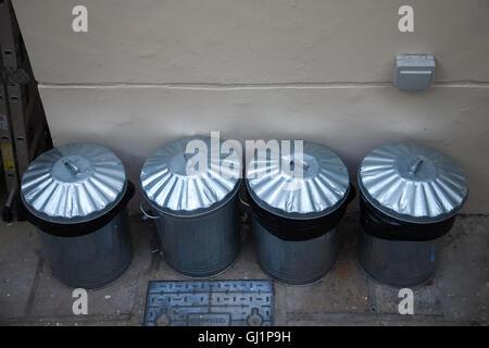 Row of aluminum or metallic trash cans / bins. London, UK - 2016. - Stock Photo