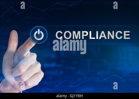 double exposure business hand clicking compliance button with blurred background - Stock Photo