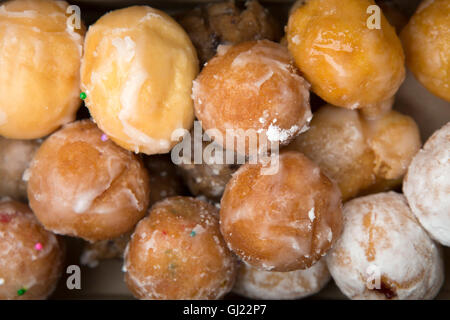A box of Timbits served in Canada. The glazed, bite-sized pieces of doughnut are served at Tim Horton's stores. - Stock Photo