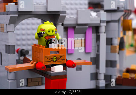 Tambov, Russian Federation - July 20, 2016 Lego Angry Birds. Foreman Pig sitting in TNT box with wings at King Pigs - Stock Photo