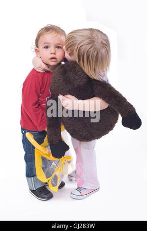 Little girl kissing little boy - Stock Photo
