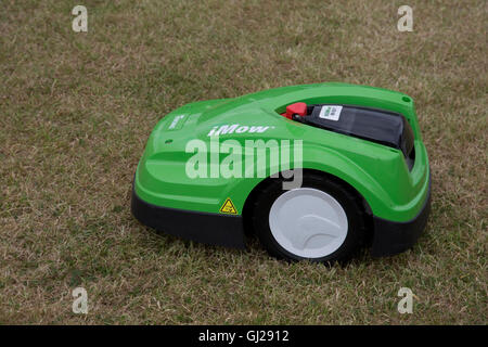 Green Viking MI 422 P iMow robotic lawn mower cutting grass Countryfile Live Blenheim UK - Stock Photo