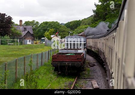 Steam tank locomotive-hauled train approaching Glyndyfrdwy Station on the Llangollen railway in North Wales. - Stock Photo