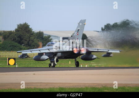 Tornado GR4 from 41 (R) Test and Evaluation Squadron based at RAF Coningsby in Lincolnshire takes off using afterburner. - Stock Photo