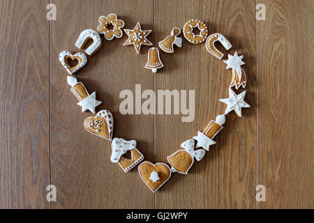 Christmas background with cookies on the wooden board (heart shape frame) - Stock Photo