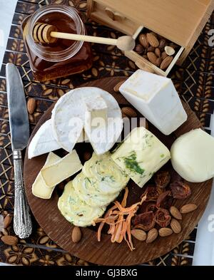 Cheese platter with assorted cheese and nuts - Stock Photo