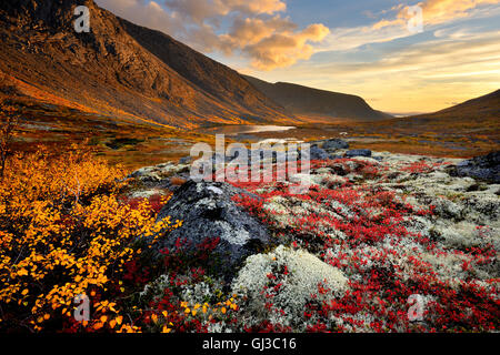 Autumn coloured valley and Malaya Belaya river, Khibiny mountains, Kola Peninsula, Russia - Stock Photo