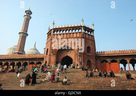 DELHI, INDIA - NOVEMBER 30: worshippers are walking on courtyard of Jama Masjid Mosque - main mosque of Old Delhi, - Stock Photo
