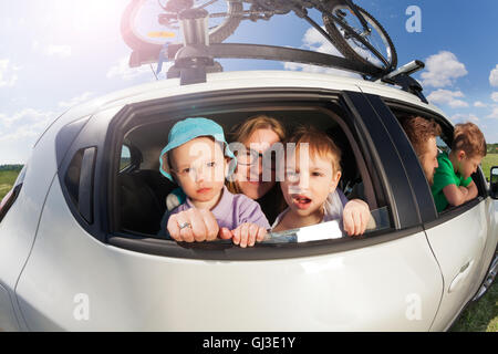 Big happy family going on vacation trip in summer - Stock Photo