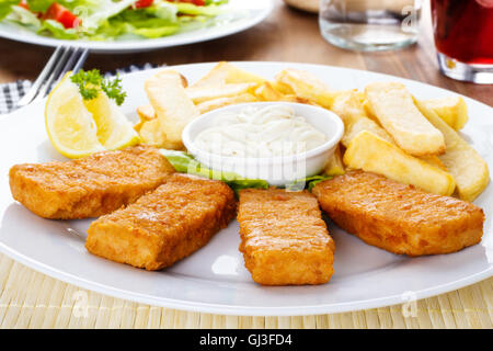 Breaded fish filets with french fries and tartar sauce. - Stock Photo