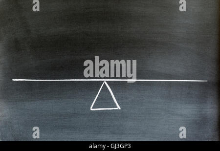 seesaw or scale in equilibrium drawn on chalkboard. - Stock Photo