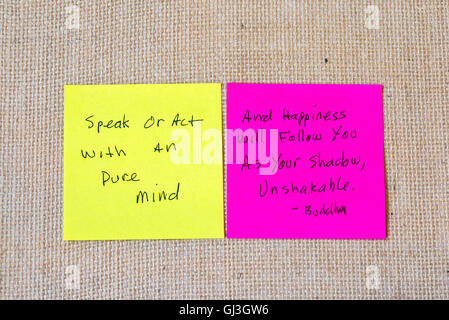 quote by Buddha written on sticky notes on a burlap background. - Stock Photo