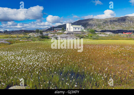 Small white wooden church in wilderness, Arctic Norway - Stock Photo