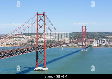 Ponte 25 de Abril across the Tagus river and view on the center of Lisbon, Portugal - Stock Photo