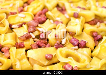 bacon pasta closeup cappelletti background - Stock Photo