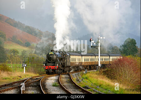 The Corwen Revival steam train approaching Carrog station on the Llangollen Heritage Line, North Wales, UK - Stock Photo
