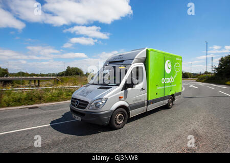 Ocado & Morrisons livery supermarket grocery delivery service food store vehicles; online delivery fleet delivering, - Stock Photo